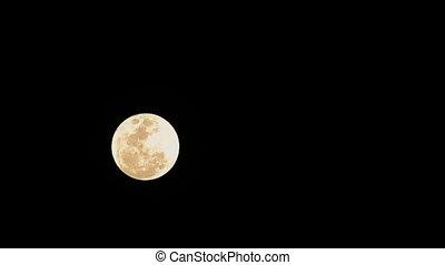 Full moon moving across the sky. - Full moon moving across...