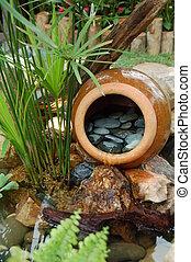 Tropical garden - A tropical garden decorated with a big...
