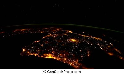 Planet Earth at night seen from the ISS. Elements of this video furnished by NASA.
