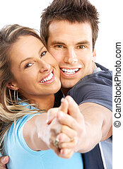 couple - Happy smiling couple in love Over white background...