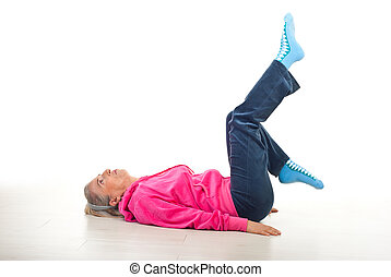 Senior woman workout - Senior woman lying down on floor and...