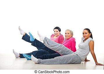 Group of women lifting legs - Group of women doing sport...