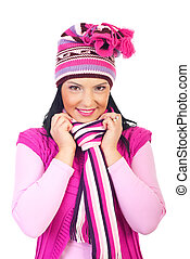 Beautiful woman in pink woolen cap and muffler