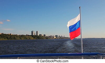 The Russian flag waving at the stern of the passenger ship...