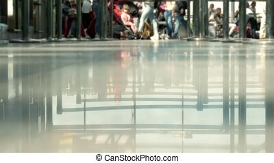 Background: Blurred people walk at the airport. Zones for...