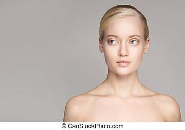 Portrait Of A Beautiful Young Blond Woman With Perfect Skin.