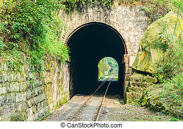Tunnel and steam narrow-gauge railway. - Tunnel and steam...