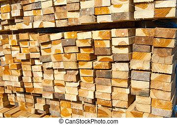 Stack of teak wood in lumber yard. pile Wooden