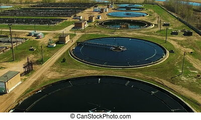 Aerial view of Wastewater treatment plant. Drone moving...