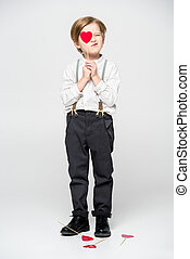 Boy with red heart sigh - Stylish little boy holding red...