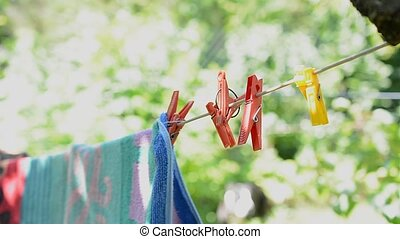 Towels swinging and hanging in the sun with bokeh.