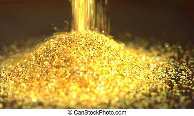 Fallen golden glitter dust. Gold sparkles fall to a pile