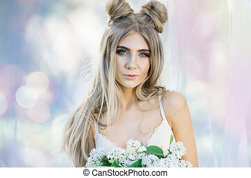 Sexy young woman in bra with lilac flowers