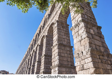 Partial view of the Roman aqueduct located in the city of Segovia, Unesco World Heritage Site, Spain
