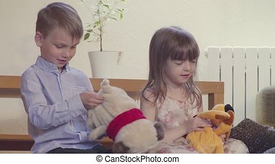 Girl and boy opening the toys and find sweets inside