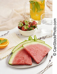 watermelon, strawberries and cold tea - some slices of...