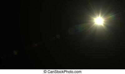"""Bright Lens Flare flashes on a black "" - ""Bright Lens Flare..."