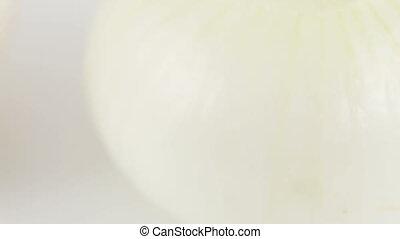 Peeleds two onions - Rotating two peeled onion bulbs
