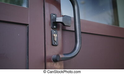 Man Unlocking a Door and Coming In
