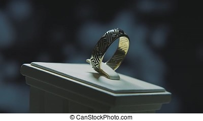 Precious diamond rings. Fine luxury diamond jewellery window display with ring pedant. Gold ring with brilliant isolated on black background