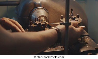 Production of rings. Jeweler working with wax model ring in his workshop. Craft jewelery making. Detail shot with low depth of field. Jeweler making handmade jewelry on vintage workbench. Craft of jewelery making.