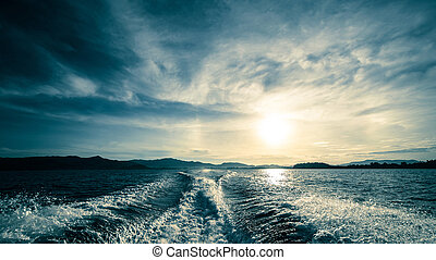 Motor boat water traces in open caribbean sea. Travel...