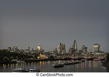 skyscrapers in london city with st paul's cathedral at night...