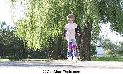 little girl learn to roller skate