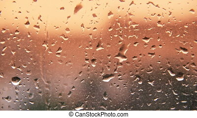 HD rain water drops on the windows glass during sunset