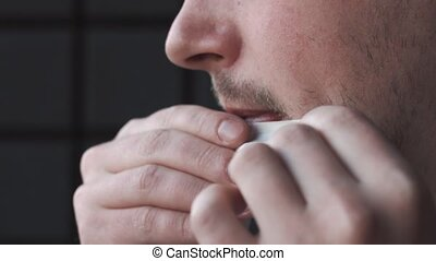 Man prepares a roll-up of tobacco.