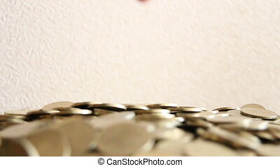 Male hand putting coin - Saving Money Concept With Hand...