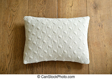 Cushion - Individual textured cushion on a wooden background