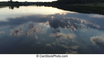 Sunset lake drone reflection - Sunset on a lake mirorr...