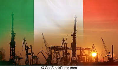 Industrial concept with Italy flag at sunset, silhouette of...