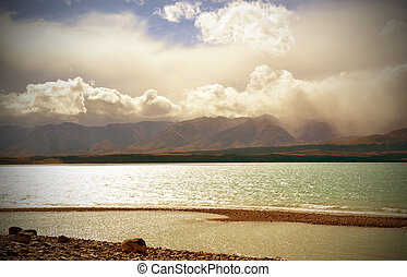 Lake Pukaki, New Zealand - Clouds rolling in over mountains...