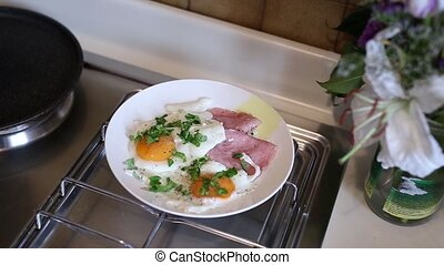 Scrambled eggs sunny side up on a plate with sausage. The...