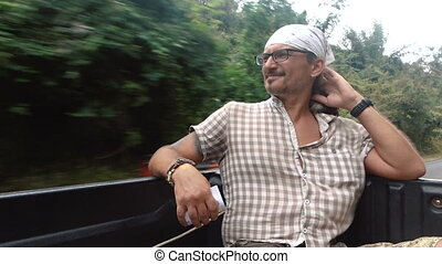 A man in a pickup truck - Video of a man sitting in the back...