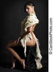 Nude with fur - Portrait of the beautiful naked girl with...