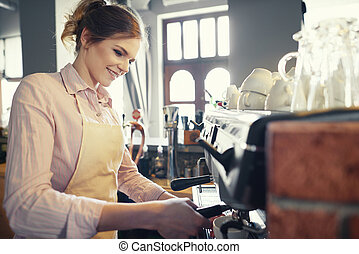 Waist up of preparation coffee by waitress