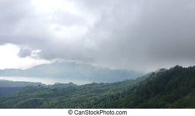 Time lapse,fog and clouds over a volcano and an lake Gunung-Batur or Batur, Bali Indonesia