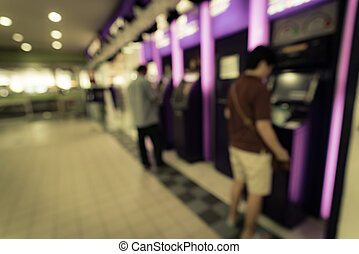 Blurred image of People at ATM