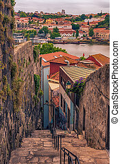 Porto, Portugal: traditional narrow street in the old town,...