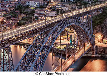 Porto, Portugal: the Dom Luis I Bridge and the old town at...