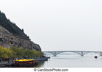 view of bridge on Yi river and West Hill - travel to China -...