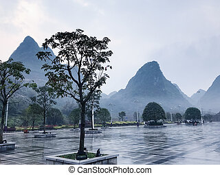 wet square and view of karst peaks in XingPing - travel to...
