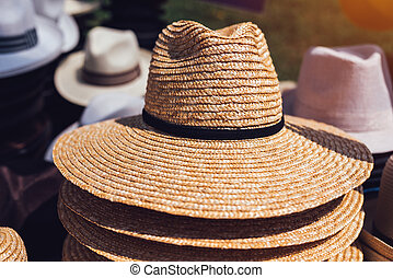 Selling classic straw hats on street market