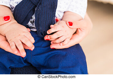 Family Baby Hands. Mother Holding Newborn Kid. Child Hand Closeup into Parents