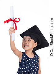 Asian Little Chinese girl wearing graduation cap and holding...