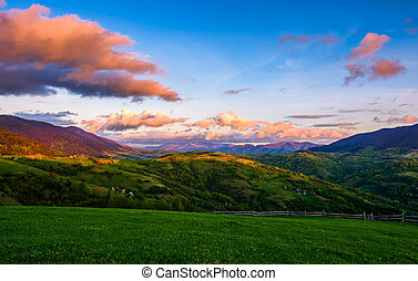 countryside landscape in mountains at sunset. grassy meadow...