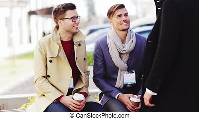 business team with conference badges and coffee - business,...